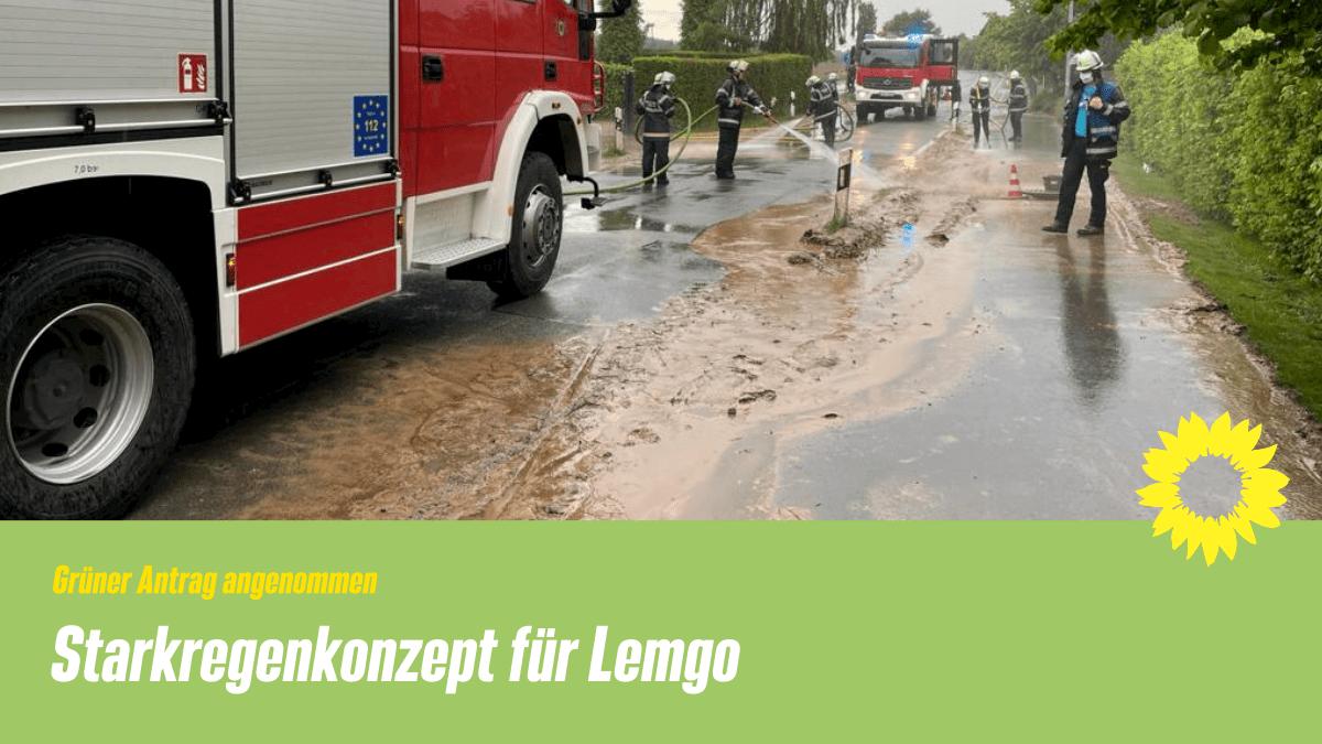 Beitragsbild: Feuerwehreinsatz wegen Schlamm auf Fahrbahn. Text: Grüner Antrag angenommen - Starkregenkonzept für Lemgo